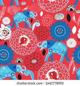 Seamless bright pattern of blue elephants on a floral red background. Template for Wallpaper or fabric.