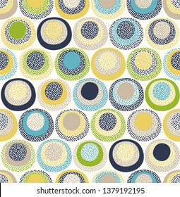 seamless childish abstract colorful round circle dots pattern on white background.