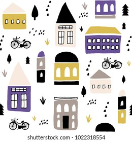 Seamless childish pattern with hand drawn houses. Creative kids city texture for fabric, wrapping, textile, wallpaper, apparel. Vector illustration