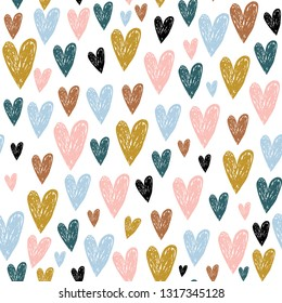 Seamless childish pattern with hand drawn hearts.Creative scandinavian kids texture for fabric, wrapping, textile, wallpaper, apparel. Vector illustration