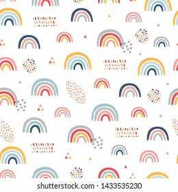 Seamless childish pattern with hand drawn rainbows. Creative scandinavian kids texture for fabric, wrapping, textile, wallpaper, apparel. Vector illustration