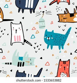 Seamless childish pattern with ink drawn cats in different poses. Creative kids hand drawn texture for fabric, wrapping, textile, wallpaper, apparel. Vector illustration