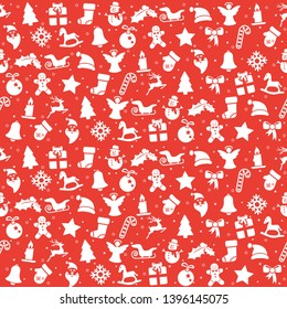seamless christmas background colored red consists of typical christmas icons like santa claus, candle, snowfalke, tree, gingerbread man, stars