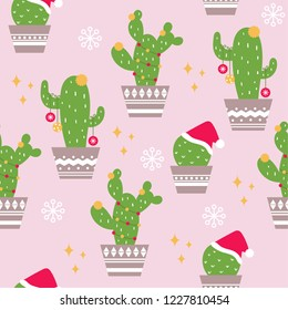 Seamless christmas pattern with cute cactus and pastel pink background