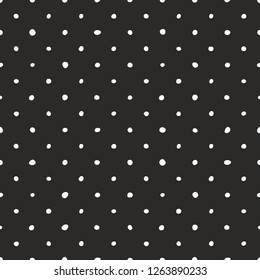 Seamless dark vector pattern with tile white polka dots on black background