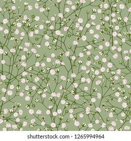 Seamless decorative vector pattern of white small flowers gypsophila on a light green background.