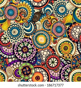 Seamless doodle flower background in vector. Circles ethnic floral pattern. Used Clipping mask for easy editing.