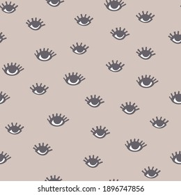 Seamless doodle pattern with eyes on a beige background. Vector funny hand drawn background.