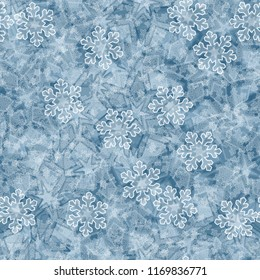 Seamless editable ice color pattern. In the foreground of the picture are painted translucent snowflakes of different sizes.
