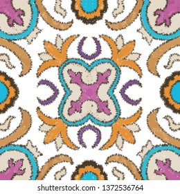 Seamless ethnic ikat floral pattern. mixed color tile