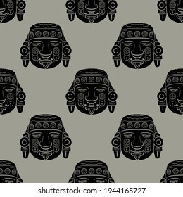 Seamless ethnic monochrome pattern with Aztec sculpture heads. Native American art.