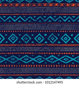 Seamless ethnic ornament. Aztec and tribal motifs. Ornament drawn by hand. Blue and orange colors. Horizontal lines. Print for your textiles. Vector illustration.