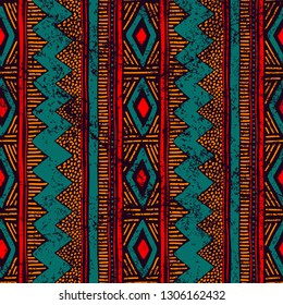 Seamless ethnic ornament. Aztec and tribal motifs. Ornament drawn by hand. Blue, red and orange colors. Vertical lines. Print for your textiles. Vector illustration.