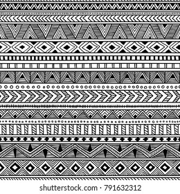 Seamless ethnic pattern. Black and white striped background. Aztec and tribal motifs. Prints for textiles. Vector illustration.