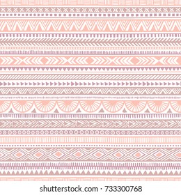 Seamless ethnic pattern. Tribal and aztec motifs. Striped vintage print. Pink, purple and white colors. Trend print for textiles. Vector illustration.