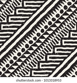 Seamless ethnic and tribal pattern. Hand drawn ornamental stripes. Black and white print for your textiles. Vector geometric background.