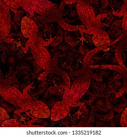 Seamless exotic tropical vector pattern with gecko lizards in shades of red on the background of the mandala