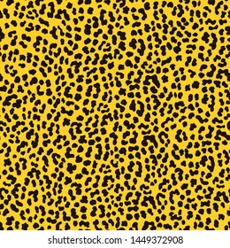 Seamless Faux Leopard print pattern with black spots on yellow background. Vector EPS10 animal repeat surface pattern. Punk rock 80s style fashion pattern.