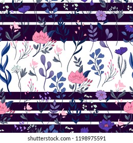 Seamless floral ditsy pattern with wild flowers on ribbon backgr