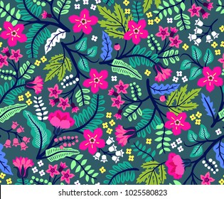 Seamless floral pattern for design. Small multicolored flowers. Dark blue background. Modern floral texture. A allover floral design in bright colors. The elegant the template for fashion prints.