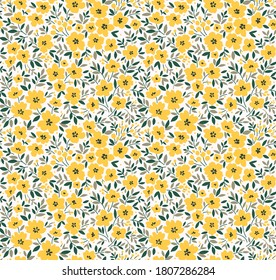 Seamless floral pattern for design. Small yellow flowers. White  background. Modern floral pattern. elegant template for fashion prints.