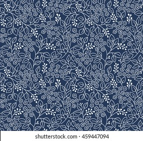 Seamless floral pattern for design. Small white flowers and leaves. Dark blue fond. Modern floral background. The elegant the template for fashion prints.
