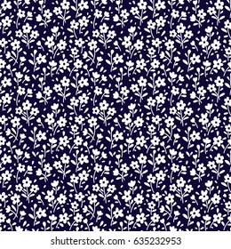 Seamless floral pattern for design. Small white flowers. Navy blue background. Modern floral texture. A allover floral design. The elegant the template for fashion prints.