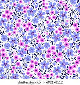 Seamless floral pattern for design. Small blue and lilac flowers. White background. Modern floral texture. A allover floral design in bright colors. The elegant the template for fashion prints.