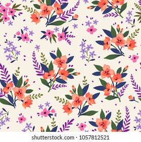Seamless floral pattern with exotic flowers. Orange lilies flowers on a white background. Branches and points with small flowers are scattered on the surface. A bouquet flowers for fashion prints.