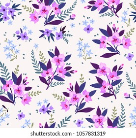 Seamless floral pattern with exotic flowers. Pink lilies flowers on a white background. Branches and points with small flowers are scattered on the surface. A bouquet flowers for fashion prints.