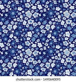 Seamless floral pattern with small blue flowers. Ditsy print in hand-drawn style. Simple cute flowery background for textile, book covers, wallpapers, print, gift wrap, scrapbooking... Vector.