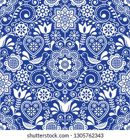 Seamless folk art vector pattern with birds and flowers, Scandinavian repetitive floral design in white on navy blue.Retro style navy blue ornament, Scandi cute background perfect for textile design,