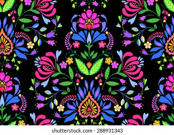 seamless folk pattern with Polish and Mexican influence. trendy ethnic decorative flowers in symmetric allover design. for fashion, interior, stationery, web.