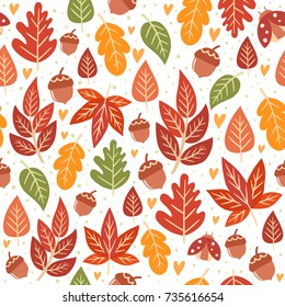 Seamless forest pattern with acorns and autumn leaves. Fall background. Vector wallpaper.