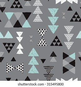 Seamless geometric mint pastel blue black gray and white tribal triangle arrow hand drawn pastel background pattern in vector