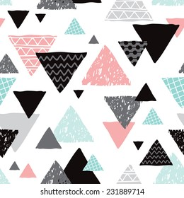 Seamless geometric mint tribal triangle hand drawn pastel background pattern in vector