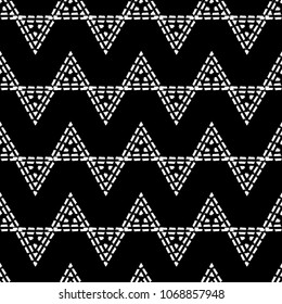 Seamless geometric pattern. Black and white texture. Drawn triangles. Drops texture. Brushwork. Scribble texture. Textile rapport.