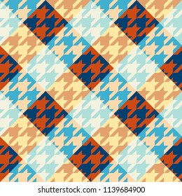 Seamless geometric pattern. Classic Hounds-tooth pattern in a patchwork plaid style. Vector image.