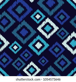 Seamless geometric pattern. The texture of the squares. Embroidery on fabric. Textile rapport.