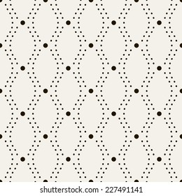 Seamless geometric pattern. Vertical wavy dotted stripes. Vector repeating texture with circles
