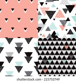 Seamless geometric tribal triangle hand drawn pastel background pattern in vector
