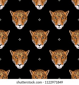Seamless geometrical pattern with leopard or jaguar faces and polka dots.