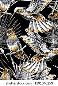 Seamless gold and silver pattern. Tropical leaves. Exotic fan palm and Hummingbird on a black background. Textile composition, hand drawn style print. Vector illustration.