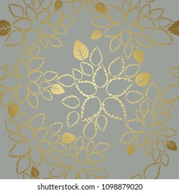 Seamless golden lace leaves pattern on grey background.