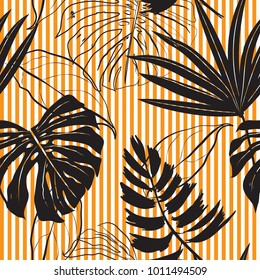 Seamless Hand Drawn black silhouette tropical leaves  Pattern on bright orange stripes Print vector