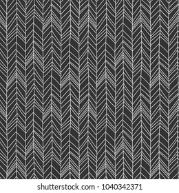 Seamless hand drawn chevron pattern with imperfect shapes line. Isolated in black background.