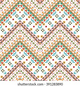 Seamless hand drawn chevron pattern with aztec ethnic and tribal ornament. Vector bright colors boho fashion illustration.