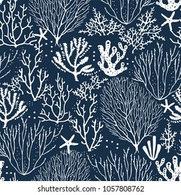 Seamless hand drawn pattern with coral reef and starfishes. Vector white illustration on dark blue background.