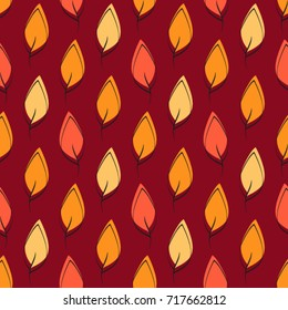Seamless hand drawn pattern made with multicolored autumn leafs
