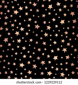 Seamless Handdrawn stars copper foil on black vector background. Pattern for Christmas and celebrations. Hand drawn rose gold stars for gift wrapping paper, greeting cards, wallpaper, posters, banners